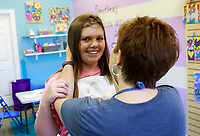 NWA Democrat-Gazette/CHARLIE KAIJO (From right) Melanie Hewins embraces Hannnah Shook, 12, of Fayetteville during a summer art workshop, Thursday, July 5, 2018 at Imagine Studios in Rogers. <br /><br />Imagine Studios will host nine weeks of summer art camps and workshops, each with different themes. Activities include canvas painting, pottery painting, slime making and water color painting.
