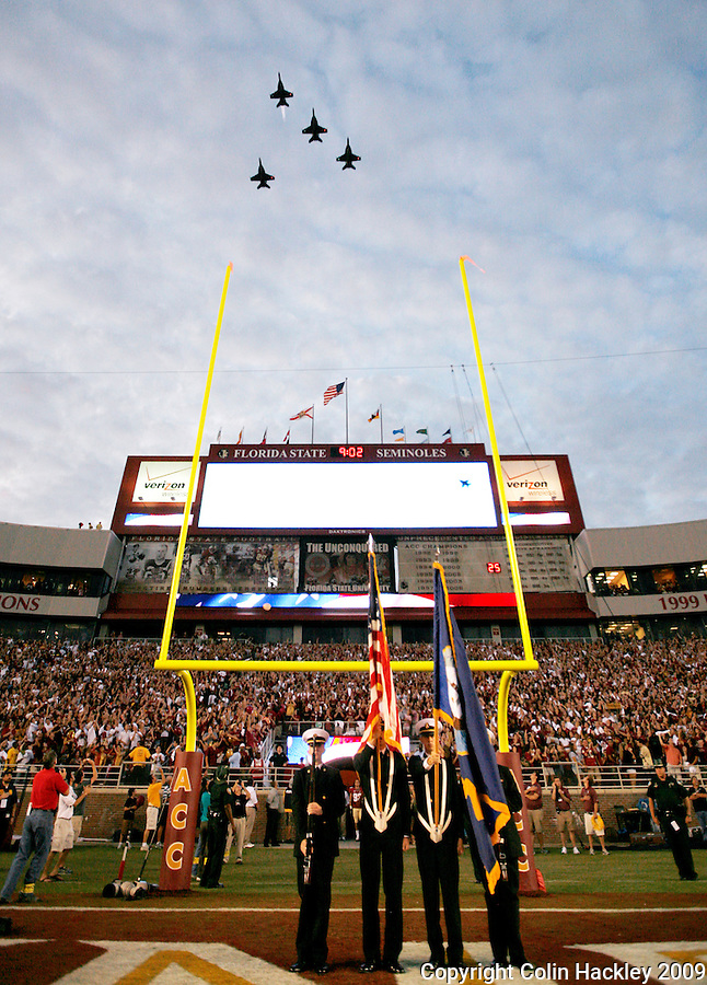 TALLAHASSEE, FL 9/7/09-FSU-MIAMIFB09 CH46-F/A-18 Hornets fly the missing man formation in honor of Navy Pilot and FSU graduate Scott Speicher (July 12, 1957- January 17, 1991) prior to the game Monday at Doak Campbell Stadium in Tallahassee. .COLIN HACKLEY PHOTO