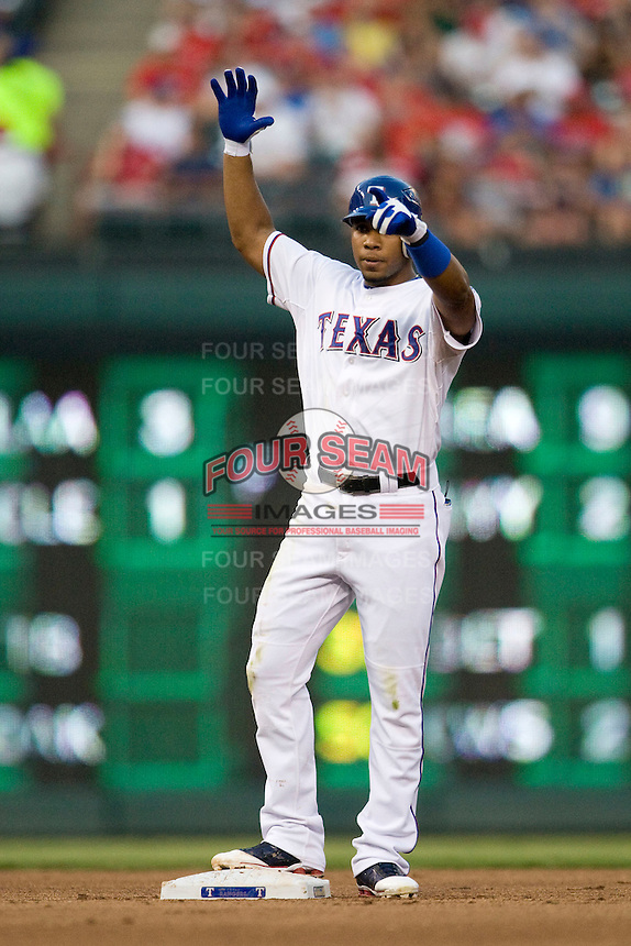 """Texas Rangers shortstop Elvis Andrus #1 gives his dugout """"the claw"""" following his fourth inning double during the Major League Baseball game against the Texas Rangers at the Rangers Ballpark in Arlington, Texas on July 27, 2011. Minnesota defeated Texas 7-2.  (Andrew Woolley/Four Seam Images)"""