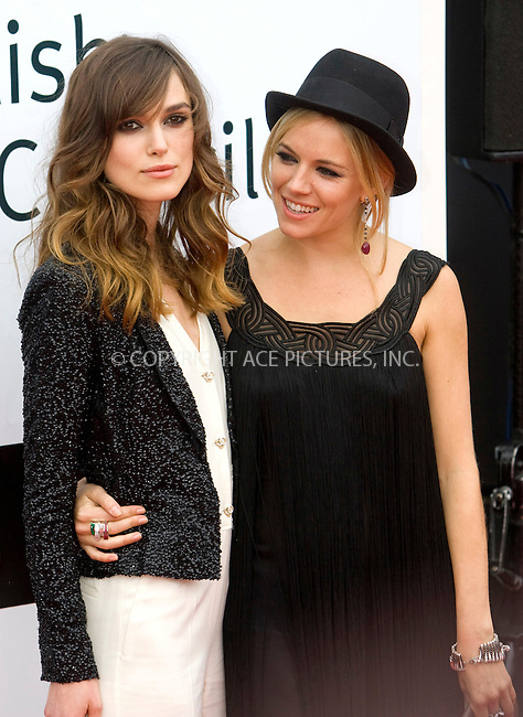 Sienna Miller and Keira Knightley at the world premiere of The Edge Of Love at the Edinburgh International Film Festival in Scotland - 18 June 2008 ..FAMOUS PICTURES AND FEATURES AGENCY 13 HARWOOD ROAD LONDON SW6 4QP UNITED KINGDOM tel +44 (0) 20 7731 9333 fax +44 (0) 20 7731 9330 e-mail info@famous.uk.com www.famous.uk.com .FAM23364