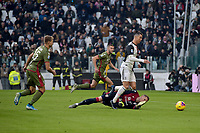 6th January 2020; Allianz Stadium, Turin, Italy; Serie A Football, Juventus versus Cagliari; Cristiano Ronaldo of Juventus goes by goalkeeper Robin Olsen of Cagliari and scores in the 49th minute - Editorial Use