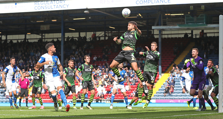 Doncaster Rovers' Danny Andrew heads the ball away from goal<br /> <br /> Photographer Rachel Holborn/CameraSport<br /> <br /> The EFL Sky Bet League One - Blackburn Rovers v Doncaster Rovers - Saturday August 12th 2017 - Ewood Park - Blackburn<br /> <br /> World Copyright &copy; 2017 CameraSport. All rights reserved. 43 Linden Ave. Countesthorpe. Leicester. England. LE8 5PG - Tel: +44 (0) 116 277 4147 - admin@camerasport.com - www.camerasport.com
