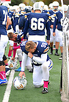 Lyvoming College football. Player praying.