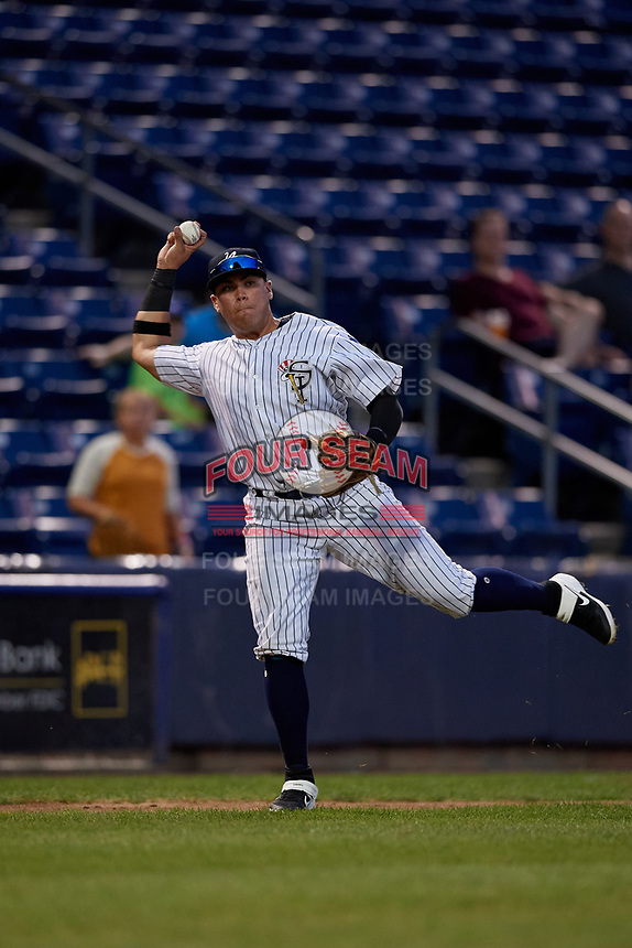 Staten Island Yankees third baseman Andres Chaparro (30) throws to first base during a NY-Penn League game against the Aberdeen Ironbirds on August 22, 2019 at Richmond County Bank Ballpark in Staten Island, New York.  Aberdeen defeated Staten Island 4-1 in a rain shortened game.  (Mike Janes/Four Seam Images)