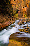 Cascade water over rocks in the Virgin River Narrows, Zion National Park, Utah