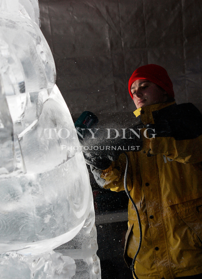 Six time world ice art champion Tajana Raukar works on his horse sculpture on Saturday, January 21, 2006 at the Plymouth Ice Spectacular, an ice carving competition that draws competitors from all over Michigan as well as Japan and Scandinavia. TONY DING/Special to the Free Press