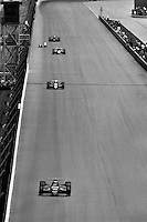 "INDIANAPOLIS, IN - MAY 26: Bobby Rahal, driving the #10 Budweiser March 85C 11/Cosworth, runs ahead of a trio of cars during ""Carburetion Day"" before the Indianapolis 500 at the Indianapolis Motor Speedway in Indianapolis, Indiana, on May 26, 1985."