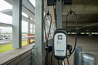 NWA Democrat-Gazette/BEN GOFF @NWABENGOFF<br /> An electric vehicle charging station Wednesday, Aug. 8, 2018, in the new parking deck at Northwest Arkansas Regional Airport. The four-level deck with 1,110 spaces opened to the public at 10:00 a.m. today. It includes electric vehicle charging stations and a parking guidance system to help drivers find empty spaces. The lighs turn red when a vehicle occupies a space, and handicapped spots have blue lights.