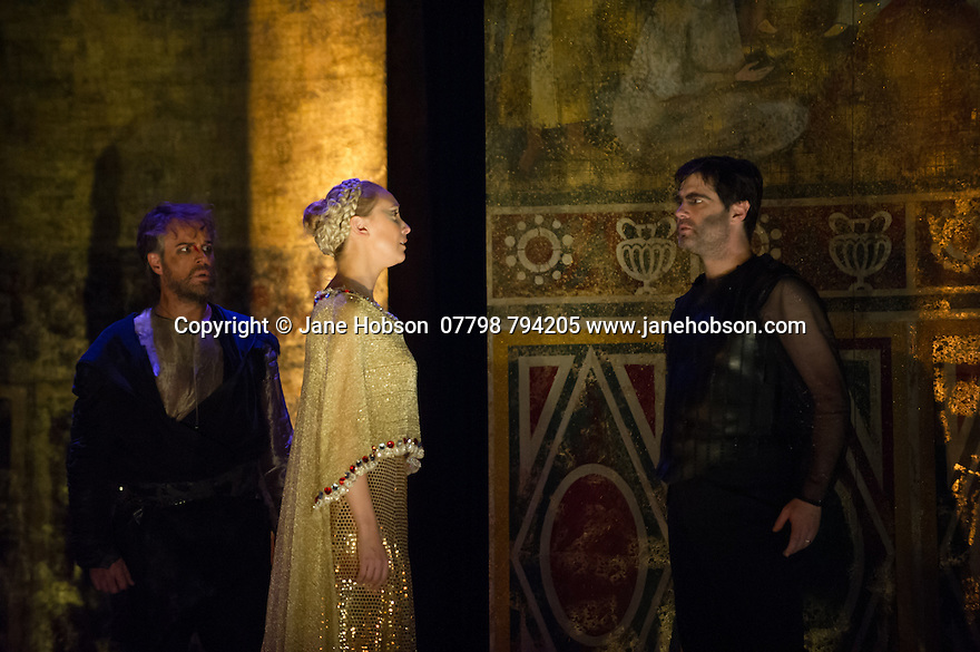 London, UK. 15.10.2014. English Touring Opera presents OTTONE, by George Frideric Handel, directed by James Conway, at the Hackney Empire. Picture shows:  Grant Doyle (Emireno), Louise Kemeny (Teofane) and Clint van der Linde (Ottone). Photograph © Jane Hobson.