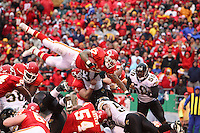 Chiefs running back Larry Johnson dives over the top for a one yard touchdown in the first quarter against the Jacksonville Jaguars at Arrowhead Stadium in Kansas City, Missouri on December 31, 2006. The Chiefs won 35-30.