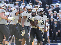 Annapolis, MD - October 21, 2017: UCF Knights players celebrate after a touchdown during the game between UCF and Navy at  Navy-Marine Corps Memorial Stadium in Annapolis, MD.   (Photo by Elliott Brown/Media Images International)