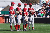 AUSTIN, TEXAS-March 6, 2011:  The Stanford infield observes the pitcher's warm up tosses during the game against the Texas Longhorns, at Disch-Falk field in Austin, Texas.  Texas defeated Stanford 4-2.