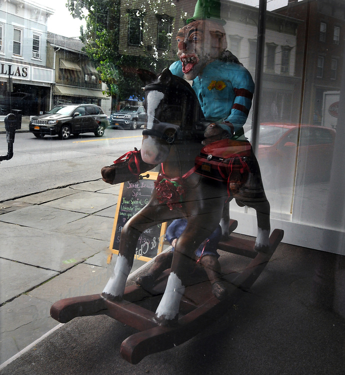 "A view of ""Clownin Around"" created by, Alan Ward, in window of the former 'Boudoir & Baby' shop at 114 Partition Street, one of the ""Rockin' Around Saugerties"" theme Statues on display throughout the Village of Saugerties, NY, on Friday, June 9, 2017. Photo by Jim Peppler. Copyright/Jim Peppler-2017."