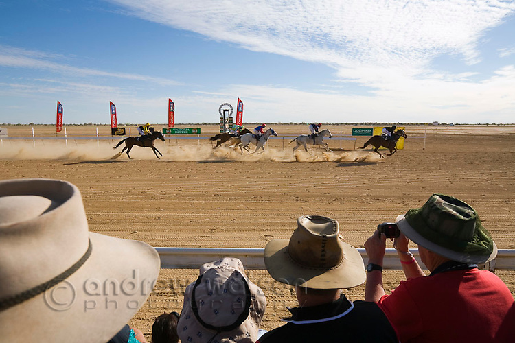 Crowds watch the annual Birdsville Cup horse races.  Every September the small outback town of Birdsville comes alive for one of the most famous horse racing festivals in Australia.  Birdsville, Queensland, AUSTRALIA.  © Andrew Watson / Axiom