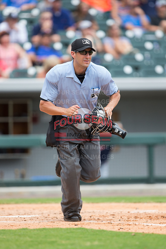 Home plate umpire Derek Mollica hustles down the first base line during the International League game between the Gwinnett Braves and the Charlotte Knights at BB&T BallPark on July 3, 2015 in Charlotte, North Carolina.  The Braves defeated the Knights 11-4 in game one of a day-night double header.  (Brian Westerholt/Four Seam Images)