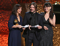 "Rashida Jones, from left, Alan Hicks and Paula DuPre Pesmen accept the award for best music film for ""Quincy"" at the 61st annual Grammy Awards on Sunday, Feb. 10, 2019, in Los Angeles. (Photo by Matt Sayles/Invision/AP)"