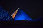 The Pyramid of Khufu, the largest of the Great Pyramids of Giza is lit in blue in honor of World Autism Awareness Day, on the outskirts of Cairo, Egypt on April 02, 2017. Photo by Amr Sayed