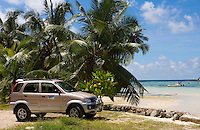 Seychelles, Island Mahe, Anse l'Islette: Jeep, rented car, beach, palm trees<br />
