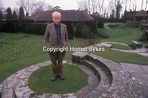 Christopher Lloyd at Great Dixter his country home. East Sussex. England Circa 1990.Portrait of the garden designer author and plantsman Winter garden