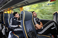 Wednesday 07 August 2013<br /> Pictured L-R: Alejandro Pozuelo and team mate Jordi Amat on the coach, en route to Cardiff Airport.  <br /> Re: Swansea City FC travelling to Sweden for their Europa League 3rd Qualifying Round, Second Leg game against Malmo.