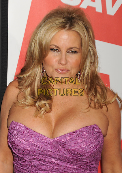 Jennifer Coolidge.The L.A. Premiere of 'American Reunion' held at The Grauman's Chinese Theatre in Hollywood, California, USA..March 19th, 2012.headshot portrait pink strapless lace cleavage .CAP/ROT/TM.©Tony Michaels/Roth Stock/Capital Pictures