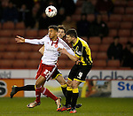 Dominic Calvert-Lewin of Sheffield Utd  and John Mousinho of Burton Albion - English League One - Sheffield Utd vs Burton Albion - Bramall Lane Stadium - Sheffield - England - 1st March 2016 - Pic Simon Bellis/Sportimage