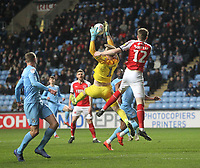 Fleetwood Town's Harry Souttar jumps with  Coventry City's Lee Burge<br /> <br /> Photographer Mick Walker/CameraSport<br /> <br /> The EFL Sky Bet League One - Coventry City v Fleetwood Town - Tuesday 12th March 2019 - Ricoh Arena - Coventry<br /> <br /> World Copyright © 2019 CameraSport. All rights reserved. 43 Linden Ave. Countesthorpe. Leicester. England. LE8 5PG - Tel: +44 (0) 116 277 4147 - admin@camerasport.com - www.camerasport.com