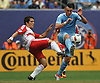 Jack Harrison #11 of NYC Football Club, right, and Connor Lade #5 of New York Red Bulls battle for possession during a Major League Soccer match at Yankee Stadium on Sunday, July 3, 2016. Harrison scored a goal early in the first half and was named player of the match in NYCFC's 2-0 win.