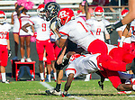 Palos Verdes, CA 10/24/14 - Michael Joncich (Peninsula #4) and Cedric Muzik (Redondo Union #1)in action during the Redondo Union - Palos Verdes Peninsula CIF Varsity football game at Peninsula High School.