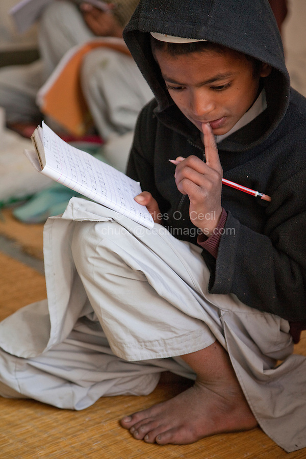 Madrasa Student Considering a Problem in Classroom, Madrasa Imdadul Uloom, Dehradun, India.