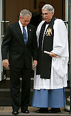 U.S. President George W. Bush walks out of St. John's Episcopal Church with Reverend  Luis León, in Washington, D.C., USA on 11 September 2007. Bush then held a moment of silence at the White House to mark the anniversary of the 9/11 terror attacks.