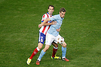 Atletico de Madrid´s Diego Godin (L) and Malmo´s Rosenberg during Champions League soccer match between Atletico de Madrid and Malmo at Vicente Calderon stadium in Madrid, Spain. October 22, 2014. (ALTERPHOTOS/Victor Blanco)