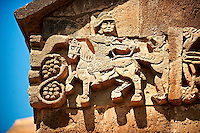 Bas Releif sculpture if a hunter in armour shooting an animal   on the outside of the 10th century Armenian Orthodox Cathedral of the Holy Cross on Akdamar Island, Lake Van Turkey 36