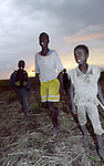 East African Rift Valley - ETHIOPIA - 15 APRIL 2004 -- Ethiopian young boys during sunset in the East African Rift Valley. --PHOTO: JUHA ROININEN / EUP-IMAGES