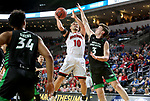 SIOUX FALLS, SD - MARCH 8: Cody Kelley #10 of the South Dakota Coyotes takes the ball to the basket against Billy Brown #3 of the North Dakota Fighting Hawks at the 2020 Summit League Basketball Championship in Sioux Falls, SD. (Photo by Dave Eggen/Inertia)