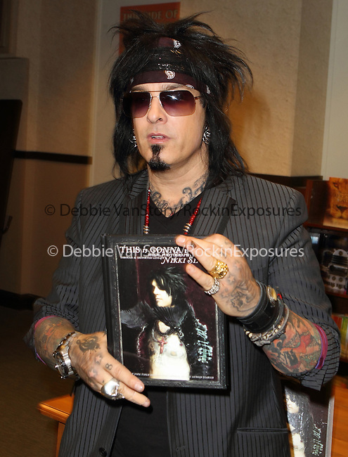Nikki Sixx, bassist and songwriter for the hard-rock band Motley Crue signs is book 'This Is Gonna Hurt: Music, Photography and Life Through the Distorted Lens of Nikki Sixx' at Barnes and Noble in Philadelphia, Pennsylvania May 5, 2011. .Copyright EML/Rockinexposures.com.