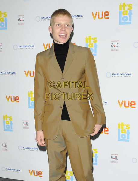 Charlie Palmer-Merkle<br /> The &quot;It's A Lot&quot; UK film premiere, Vue West End cinema, Leicester Square, London, England.<br /> October 21st, 2013<br /> half length black top beige brown suit mouth open tongue <br /> CAP/CAN<br /> &copy;Can Nguyen/Capital Pictures