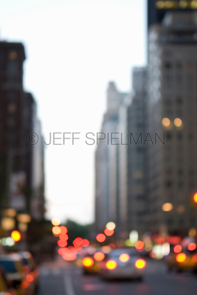 AVAILABLE FROM JEFF AS A FINE ART PRINT.<br /> <br /> AVAILABLE FROM PLAINPICTURE FOR COMMERCIAL AND EDITORIAL LICENSING.  Please go to www.plainpicture.com and search for image # p5690206.<br /> <br /> Soft Focus View of Traffic on Sixth Avenue at Dusk, Midtown Manhattan, New York City, New York State, USA