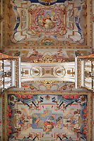Allegorical trompe l'oeil ceiling frescoes painted by Antonio Simoes Ribeiro and Vicente Nunez, in the Red Room (top) and Black Room (bottom) of the Joanina Library, or Biblioteca Joanina, a Baroque library built 1717-28 by Gaspar Ferreira, part of the University of Coimbra General Library, in Coimbra, Portugal. The Casa da Livraria was built during the reign of King John V or Joao V, and consists of the Green Room, Red Room and Black Room, with 250,000 books dating from the 16th - 18th centuries. The library is part of the Faculty of Law and the University is housed in the buildings of the Royal Palace of Coimbra. The building is classified as a national monument and UNESCO World Heritage Site. Picture by Manuel Cohen