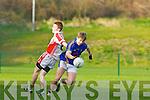 Shane O'Connor Tralee CBS  drives past Barra O'Suilleabhain in the Corn Uí Mhuirí semi final in Killarney on Sunday
