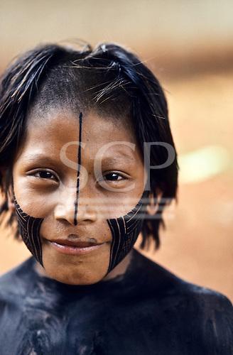 A-Ukre village, Xingu, Brazil. Bep Dja, a Kayapo Indian boy, with fresh black body and face paint.