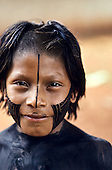 A-Ukre village, Xingu, Brazil. Bep Dja, a Kayapo Indian boy, with fresh black body and face paint.