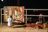 Painter Paints a Canvas During Dinner to Commemorate 10th Anniversary of Biannual Arts Festival on Goree Island, Senegal.  Progress after 45 Minutes.