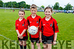 Grainne Kelliher, Harry O'Connor and Emily Buckley from Fossa enjoying a well earned rest during the Community GAA Football games in Na Gaeil on Monday.