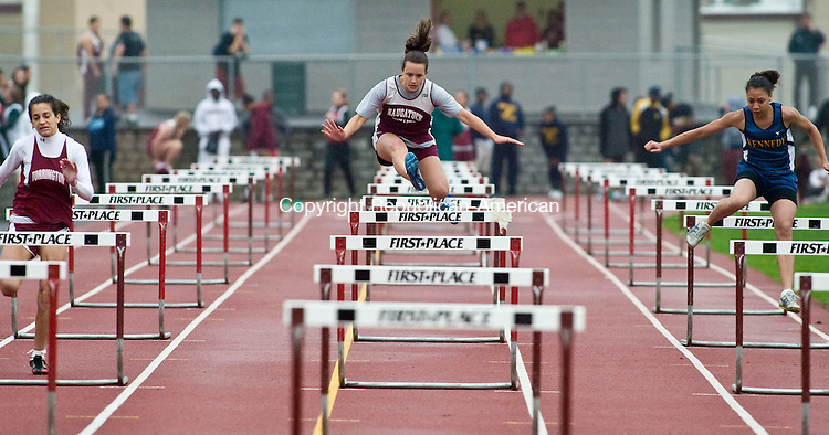 NAUGATUCK, CT - 05 MAY 2009 -050509JT12-<br /> From left, Torrington's Julia Giampaolo, Naugatuck's Jamie Girolamo and Kennedy's Irene Feliciano compete in the 100m hurdles event during Tuesday's meet at Naugatuck. Kaynor Tech also competed in the meet.<br /> Josalee Thrift Republican-American