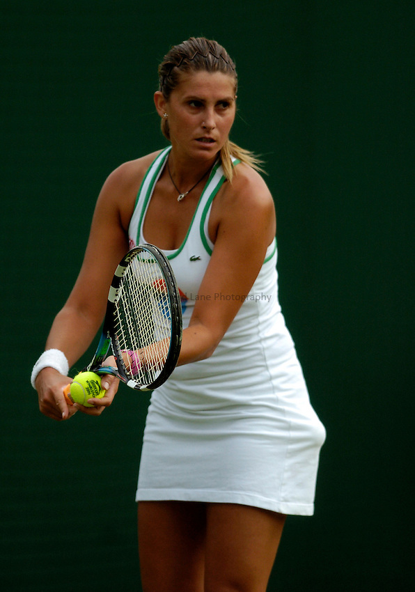 Photo: Richard Lane..Wimbledon Championships. 27/06/2006. .Spain's Maria Sanchez Lorenzo serves during her 1st round.
