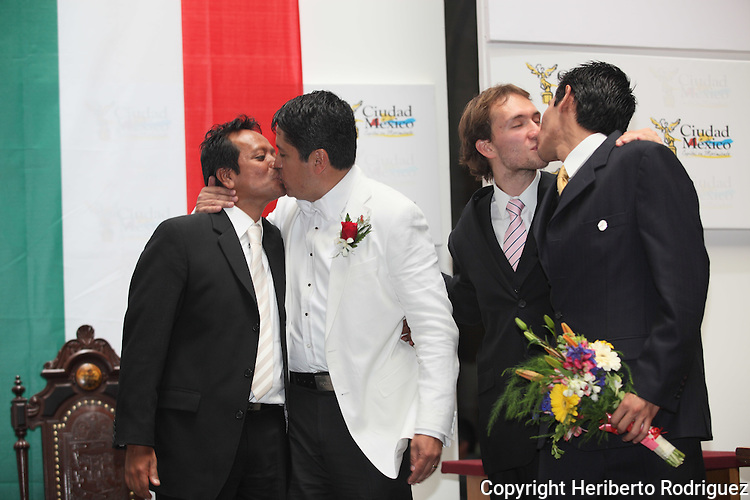Daniel Ramos Gómez y Marco Antonio Temistocles Villanueva Ramos (L) and Jaime Genaro López Vela y David Sergio González Garduño kiss each other after being married in a civil ceremony at the City Hall on March 11, 2010. For the first time in Mexico the gay marriages are being legalize although the Catholic church and the Felipe Calderon's government are opposing to the gay rights.  Photo by Heriberto Rodriguez