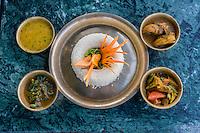 Nepal, Kathmandu, Swayambhunath.  A Nepalese Lunch:  rice, curried vegetables, chicken, spinach, lentil sauce.