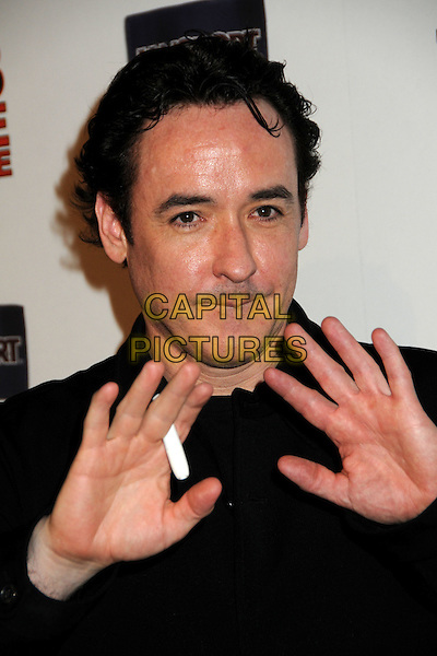 "JOHN CUSACK.""Hot Time Time Machine"" World Premiere Party held at the Cabana Club, Hollywood, California, USA..March 17th, 2010.headshot portrait black smoking cigarette nicorette stick plastic hands palms.CAP/ADM/BP.©Byron Purvis/AdMedia/Capital Pictures."