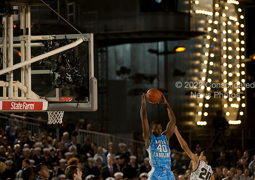 University of North Carolina's Harrison Barnes guards the ball Friday, November 11, 2011 during the Quicken Loans Carrier Classic aboard the Nimitz-class aircraft carrier USS Carl Vinson (CVN 70 in San Diego, California). Carl Vinson hosted Michigan State University and the University of North Carolina for an NCAA basketball game.  .Mandatory Credit: James R. Evans - U.S. Navy via CNP